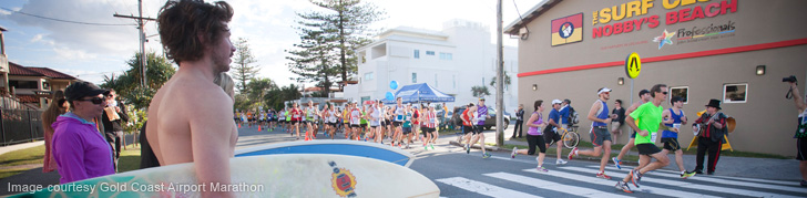 Runners Jogging Past Nobbys SLSC